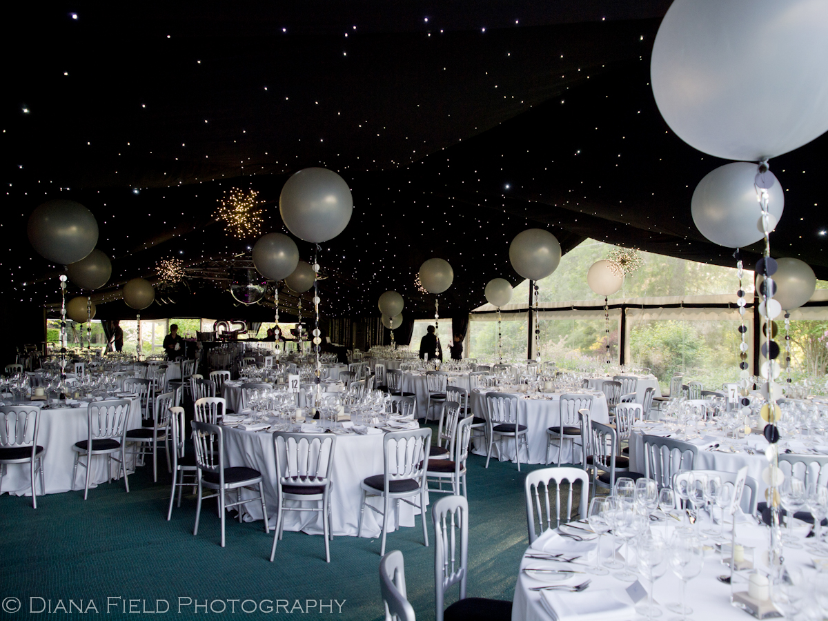 Tables all set for 50th birthday party in a marquee